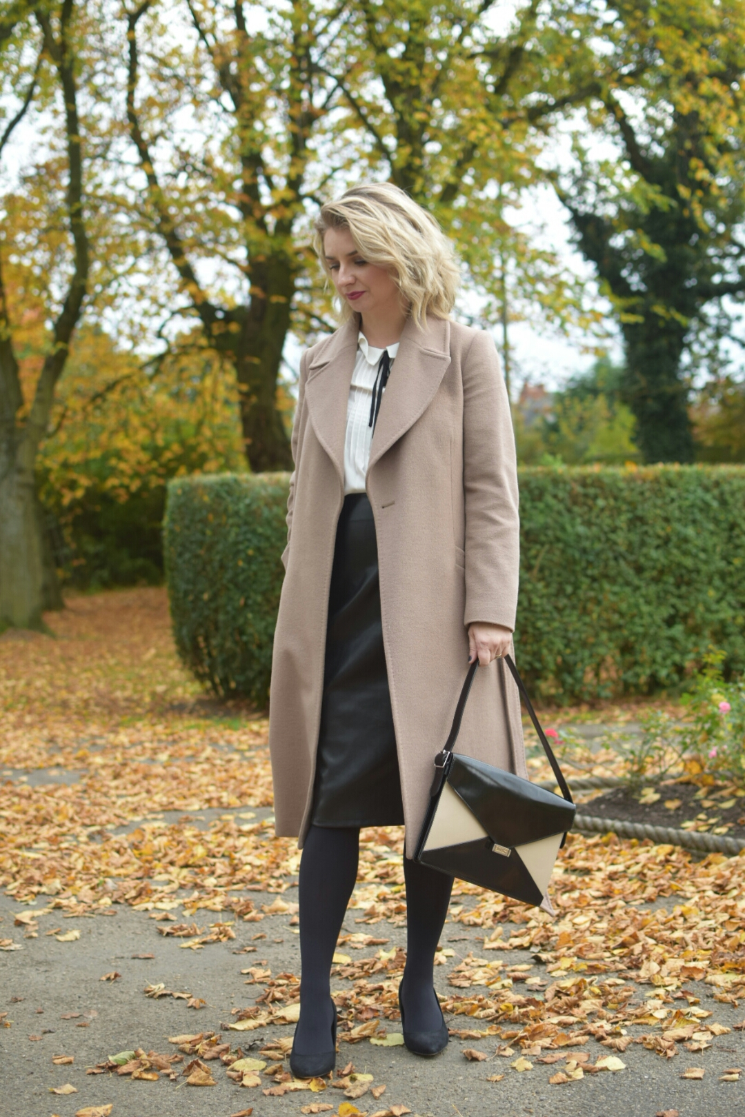 Jaegar Camel Coat, Matalan White blouse with neck tie,Leatherette Pencil Skirt, Carvela Black Court Shoes, and Celine Diamond Shoulder Bag
