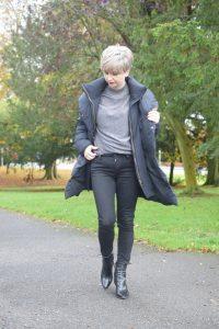 Zara Navy Puffer coat, Marks and Spencer Metallic Crew Neck Jumper, Black 711 Jeans and Zara Black Boots.
