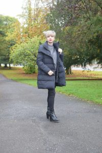 Zara Navy Puffer coat, Marks and Spencer Metallic Crew Neck Jumper, Black 711 Jeans and Zara Black Boots.
